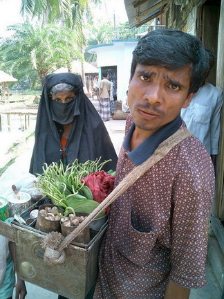 Veggie salesman and muslim woman