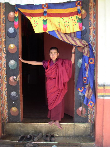 Young monk in doorway